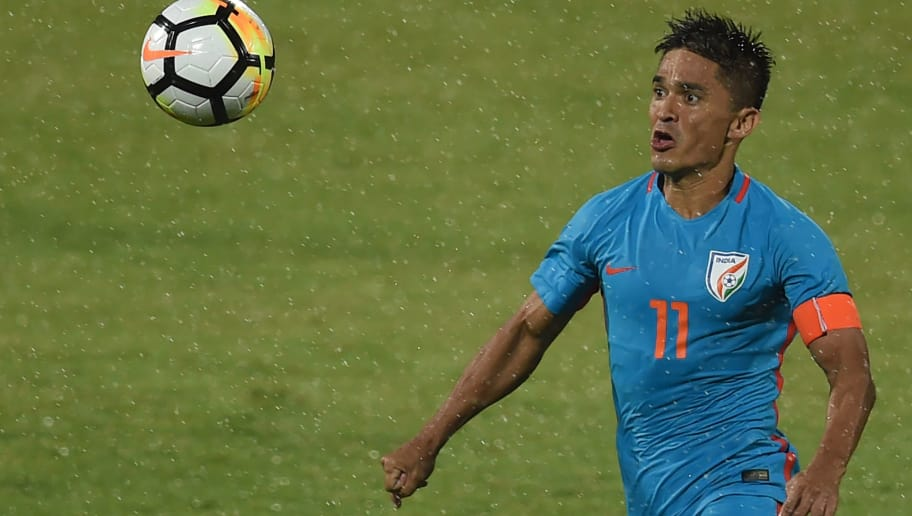 India captain Sunil Chhetri vies for the ball during the Hero Intercontinental Cup football match between India and Kenya in Mumbai on June 4, 2018. - India's football international against Kenya on June 4  was sold out in hours following captain Sunil Chhetri's emotional plea for fans to support the team after barely 2,500 people turned up to watch them play last week. (Photo by PUNIT PARANJPE / AFP)        (Photo credit should read PUNIT PARANJPE/AFP/Getty Images)