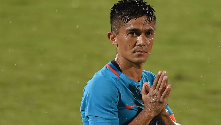 India's captain Sunil Chhetri (C) greets his team's supporters after winning the Hero Intercontinental Cup football match between India and Kenya, in Mumbai, on June 4, 2018. - India's football international against Kenya on Monday sold out in hours following captain Sunil Chhetri's emotional plea for fans to support the team after barely 2,500 people turned up to watch them play last week. (Photo by PUNIT PARANJPE / AFP)        (Photo credit should read PUNIT PARANJPE/AFP/Getty Images)