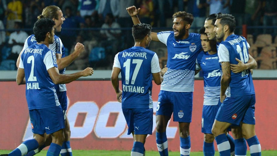Bengaluru FC players celebrate their first goal scored by their captain Sunil Chhetri (3R) during the Hero Indian Super League (ISL) football semifinal second leg match between Bengaluru FC and FC Pune City at the Shree Kanteerava Stadium in Bangalore on March 11, 2018. / AFP PHOTO / MANJUNATH KIRAN        (Photo credit should read MANJUNATH KIRAN/AFP/Getty Images)