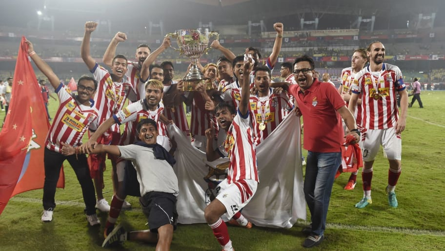 Atletico de Kolkata players celebrate with the trophy after winning the Indian Super League (ISL) final football match against Kerala Blasters FC at the Jawahar Lal Nehru Stadium in Kochi on December 18, 2016.  ----IMAGE RESTRICTED TO EDITORIAL USE - STRICTLY NO COMMERCIAL USE----- / AFP / SAJJAD HUSSAIN        (Photo credit should read SAJJAD HUSSAIN/AFP/Getty Images)