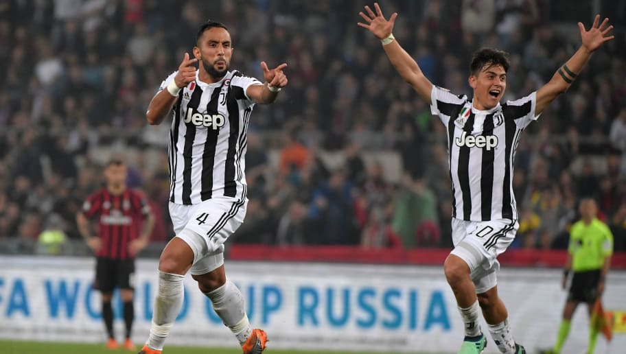 Juventus' defender from Italy Medhi Benatia (L) celebrates with teammate Juventus' forward from Argentina Paulo Dybala after scoring during the Italian Tim Cup (Coppa Italia) final Juventus vs AC Milan at the Olympic stadium on May 9, 2018 in Rome. (Photo by Tiziana FABI / AFP)        (Photo credit should read TIZIANA FABI/AFP/Getty Images)