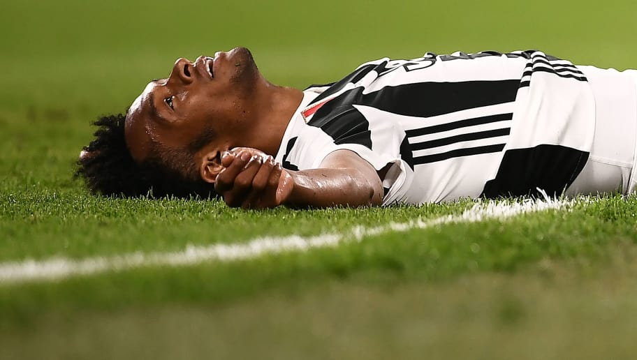 Juventus' midfielder Juan Cuadrado from Colombia reacts during the Italian Serie A football match between Juventus and Bologna on May 5, 2018 at the Allianz Stadium in Turin. (Photo by MARCO BERTORELLO / AFP)        (Photo credit should read MARCO BERTORELLO/AFP/Getty Images)