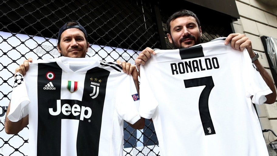 7b58fd8cf Juventus  supporters show their Cristiano Ronaldo s Juventus official  Jerseys in front of the Juventus store