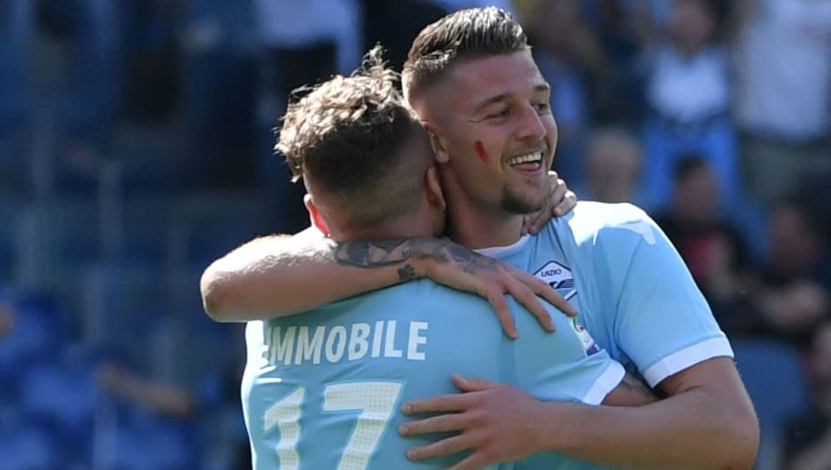 Lazio's Serbian midfielder Sergej Milinkovic-Savic (R) celebrates with Lazio's Italian midfielder Ciro Immobile after scoring a goal during the Italian Serie A football match Lazio versus Sampdoria on April 22, 2018 at the Olympic Stadium in Rome. (Photo by Andreas SOLARO / AFP)        (Photo credit should read ANDREAS SOLARO/AFP/Getty Images)