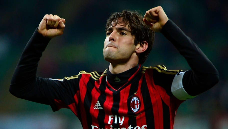 AC Milan's Brazilian forward Kaka celebrates with teammates after scoring during the Italian serie A football match AC Milan vs Chievo Verona, on March 29, 2014 in San Siro stadium in Milan. AFP PHOTO / OLIVIER MORIN / AFP PHOTO / Olivier MORIN        (Photo credit should read OLIVIER MORIN/AFP/Getty Images)