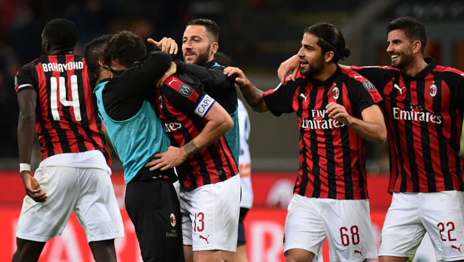 AC Milan's Italian defender Alessio Romagnoli (C) celebrates with teammates after scoring a goal during the Italian Serie A football match between AC Milan and Genoa at the San Siro stadium in Milan, on October 31, 2018. (Photo by Miguel MEDINA / AFP)        (Photo credit should read MIGUEL MEDINA/AFP/Getty Images)