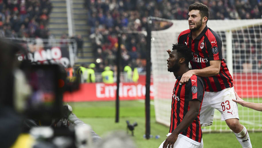 AC Milan's Ivorian midfielder Franck Kessie (C) celebrates with AC Milan's Italian forward Patrick Cutrone after scoring a penalty during the Italian Serie A football match AC Milan vs Parma on Decembre 2, 2018 at the San Siro stadium in Milan. (Photo by Miguel MEDINA / AFP)        (Photo credit should read MIGUEL MEDINA/AFP/Getty Images)