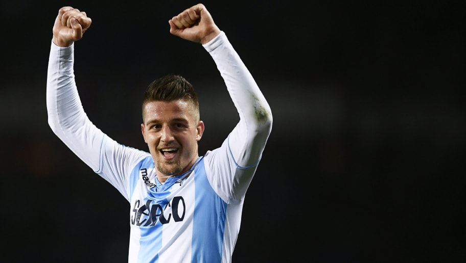 Lazio's midfielder Sergej Milinkovic-Savic from Serbia celebrates at the end of the Italian Serie A football match Torino Vs Lazio on April 29, 2018 at the 'Grande Torino Stadium' in Turin. (Photo by MARCO BERTORELLO / AFP)        (Photo credit should read MARCO BERTORELLO/AFP/Getty Images)