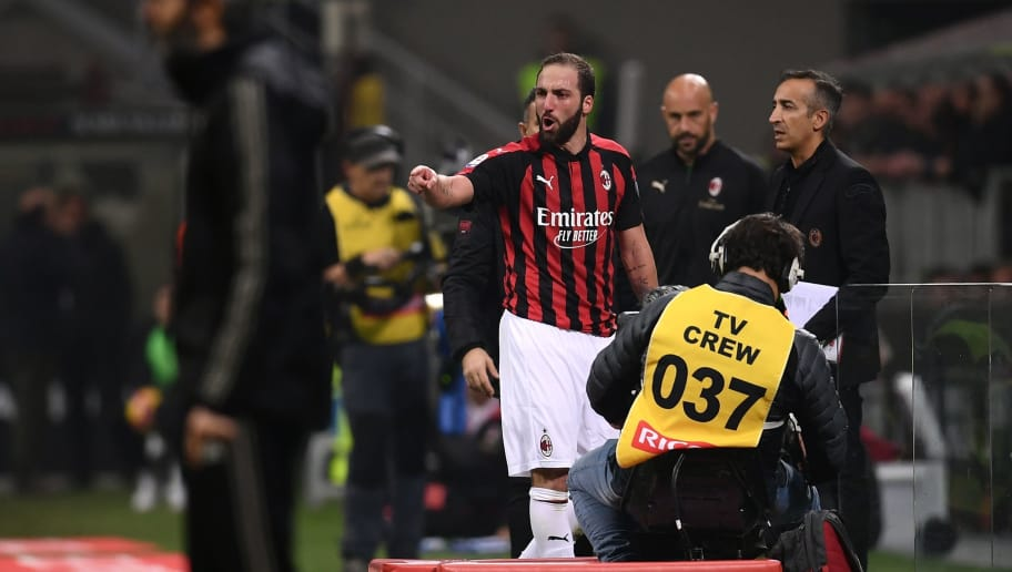 AC Milan's Argentine forward Gonzalo Higuain reacts from the side of the pitch after he received a red card during the Italian Serie A football match AC Milan vs Juventus on November 11, 2018 at the San Siro stadium in Milan. (Photo by Marco BERTORELLO / AFP)        (Photo credit should read MARCO BERTORELLO/AFP/Getty Images)