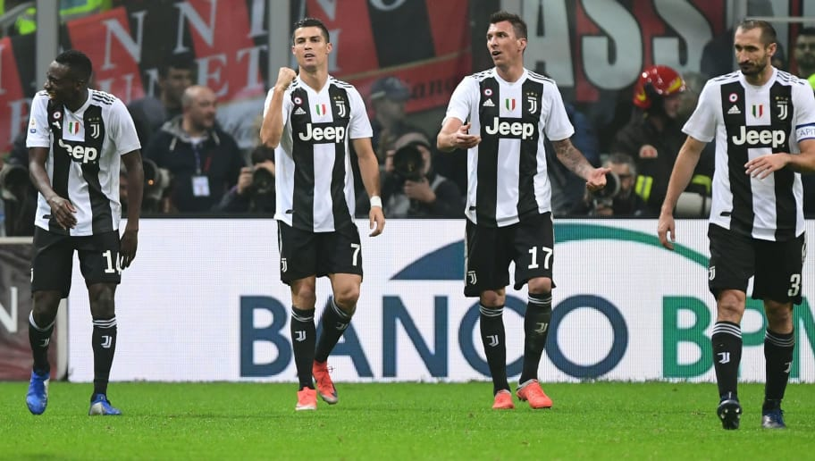 Juventus' Portuguese forward Cristiano Ronaldo (2ndL) celebrates with (From L) Juventus' French midfielder Blaise Matuidi, Juventus' Croatian forward Mario Mandzukic and Juventus' Italian defender Giorgio Chiellini after scoring during the Italian Serie A football match AC Milan vs Juventus on November 11, 2018 at the San Siro stadium in Milan. (Photo by Miguel MEDINA / AFP)        (Photo credit should read MIGUEL MEDINA/AFP/Getty Images)