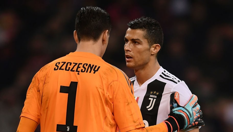 Juventus' Portuguese forward Cristiano Ronaldo (R) speaks to Juventus' Polish goalkeeper Wojciech Szczesny before a penalty for AC Milan during the Italian Serie A football match AC Milan vs Juventus on November 11, 2018 at the San Siro stadium in Milan. (Photo by Marco BERTORELLO / AFP)        (Photo credit should read MARCO BERTORELLO/AFP/Getty Images)