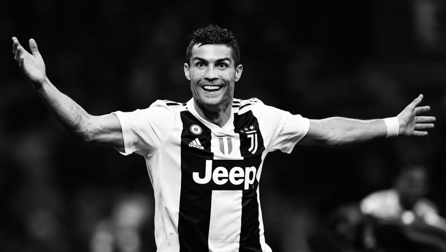 Juventus' Portuguese forward Cristiano Ronaldo celebrates after scoring during the Italian Serie A football match AC Milan vs Juventus on November 11, 2018 at the San Siro stadium in Milan. (Photo by Marco BERTORELLO / AFP) / BLACK AND WHITE VERSION        (Photo credit should read MARCO BERTORELLO/AFP/Getty Images)