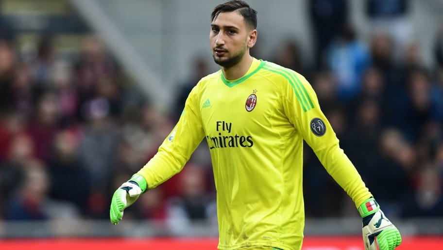 AC Milan's Italian goalkeeper Gianluigi Donnarumma reacts during the Italian Serie A football match between AC Milan and Napoli at San Siro stadium in Milan on April 15, 2018.  / AFP PHOTO / MIGUEL MEDINA        (Photo credit should read MIGUEL MEDINA/AFP/Getty Images)