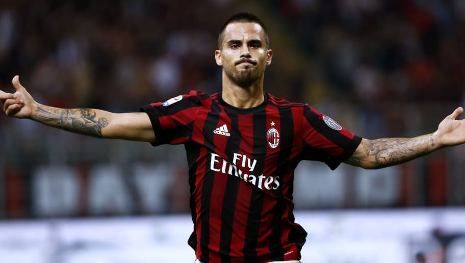 AC Milan's midfielder Suso from Spain celebrates after scoring during the Italian Serie A football match AC Milan Vs Cagliari on August 27, 2017 at the 'Giuseppe Meazza' Stadium in Milan.  / AFP PHOTO / Marco BERTORELLO        (Photo credit should read MARCO BERTORELLO/AFP/Getty Images)
