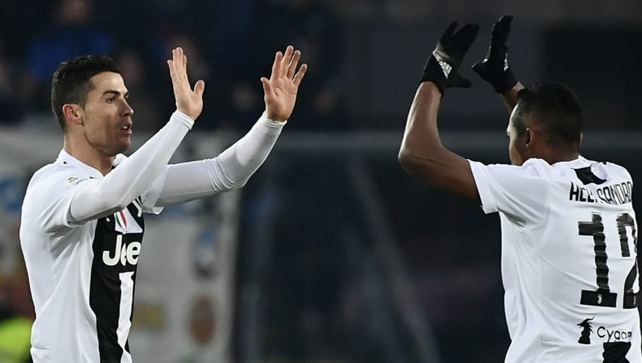 Juventus' Portuguese forward Cristiano Ronaldo (L) celebrates with Juventus' Brazilian defender Alex Sandro after scoring an equalizer during the Italian Serie A football Match Atalanta Bergamo vs Juventus on December 26, 2018 at the Atleti Azzurri d'Italia stadium in Bergamo. (Photo by Marco BERTORELLO / AFP)        (Photo credit should read MARCO BERTORELLO/AFP/Getty Images)