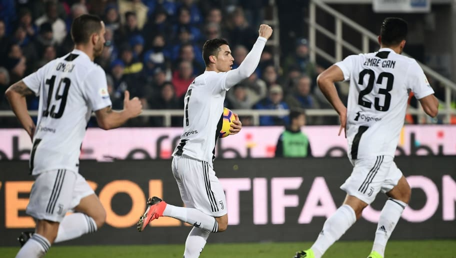 Juventus' Portuguese forward Cristiano Ronaldo (C) celebrates after scoring an equalizer during the Italian Serie A football Match Atalanta Bergamo vs Juventus on December 26, 2018 at the Atleti Azzurri d'Italia stadium in Bergamo. (Photo by Marco BERTORELLO / AFP)        (Photo credit should read MARCO BERTORELLO/AFP/Getty Images)