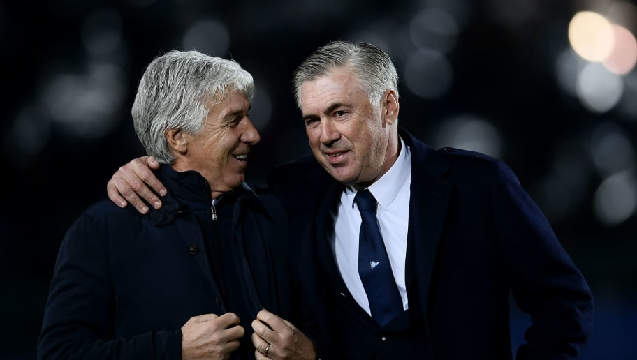 Napoli's Italian coach Carlo Ancelotti (R) hugs Atalanta's Italian coach Gian Piero Gasperini during the Italian Serie A football match Atalanta vs Napoli on December 3, 2018 at the Atleti Azzurri d'Italia Stadium in Bergamo. (Photo by MARCO BERTORELLO / AFP)        (Photo credit should read MARCO BERTORELLO/AFP/Getty Images)