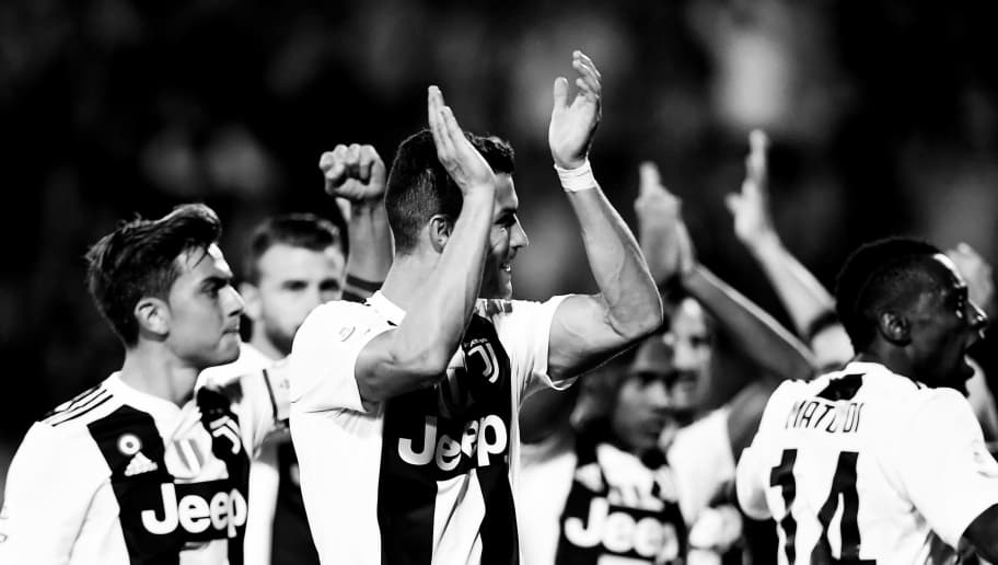 Juventus' Portuguese forward Cristiano Ronaldo celebrates at the end of the Italian Serie A football match Empoli vs Juventus on October 27, 2018 at the 'Carlo Castellani Stadium' in Empoli. (Photo by MARCO BERTORELLO / AFP)        (Photo credit should read MARCO BERTORELLO/AFP/Getty Images)