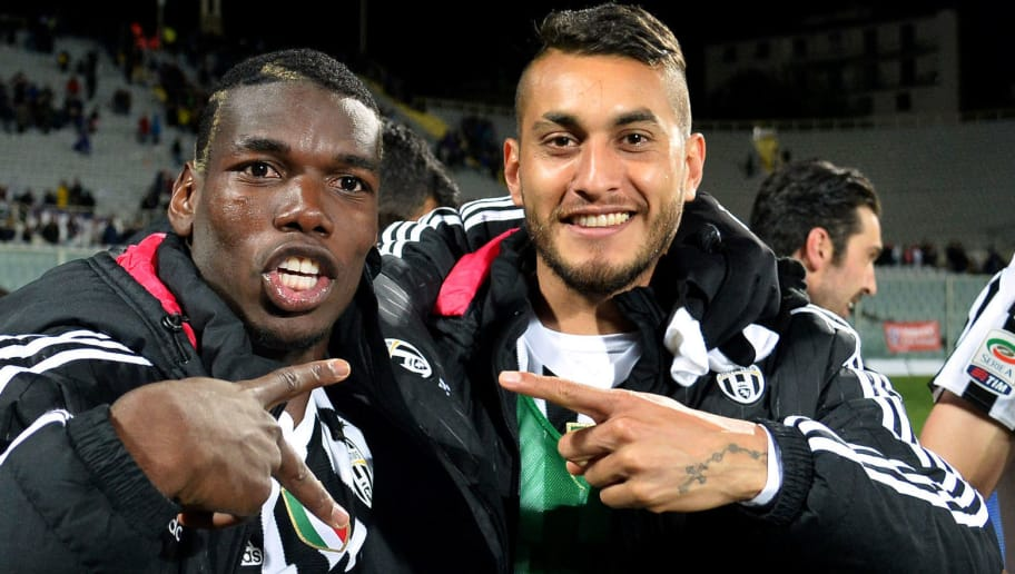 Juventus' French midfielder Paul Pogba (L) and Juventus' Argentinian midfielder Roberto Pereyra celebrates at the end of  the Italian Serie A football match Fiorentina vs Juventus on April 24, 2016 at the Artemio Franchi stadium in Florence.  / AFP / ALBERTO PIZZOLI        (Photo credit should read ALBERTO PIZZOLI/AFP/Getty Images)