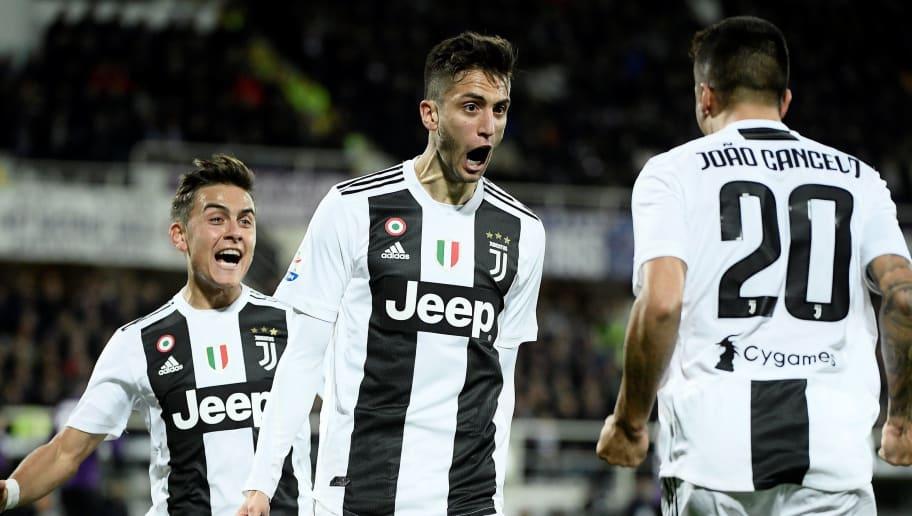 Juventus s Urugayan midfielder Rodrigo Bentancur (C) celebrates with  teammates after scoring a goal during 01fc0dcb8f3