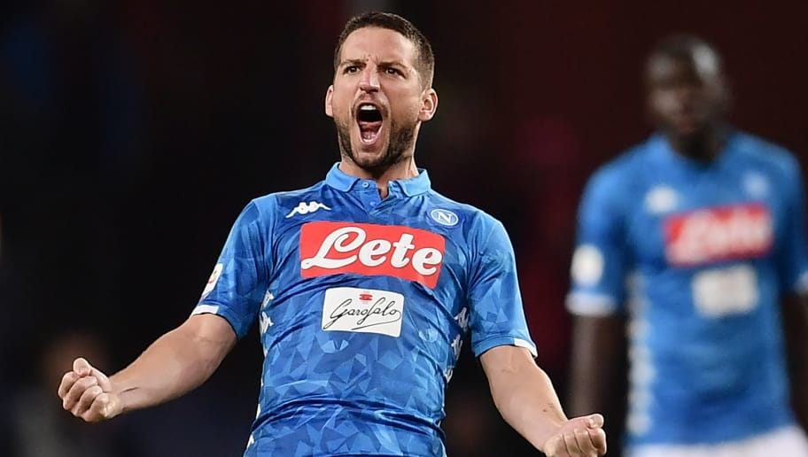 Napoli's Belgian forward Dries Mertens celebrates after Genoa scored an own goal during the Italian Serie A football match Genoa vs Napoli at the Luigi-Ferraris stadium on November 10, 2018 in Genoa. (Photo by Marco BERTORELLO / AFP)        (Photo credit should read MARCO BERTORELLO/AFP/Getty Images)