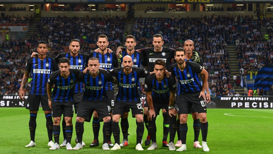 (From L, Front) Inter Milan's Italian midfielder Matteo Politano, Inter Milan's Belgian midfielder Radja Nainggolan, Inter Milan's Spanish midfielder Borja Valero, Inter Milan's Argentine forward Lautaro Martinez and Inter Milan's Italian midfielder Antonio Candreva and (From L, Rear) Inter Milan's Brazilian defender Estevao Dalbert, Inter Milan's Italian defender Danilo D'Ambrosio, Inter Milan's Dutch defender Stefan de Vrij, Inter Milan's Italian midfielder Roberto Gagliardini, Inter Milan's Slovenian goalkeeper Samir Handanovic and Inter Milan's Brazilian defender Miranda pose for a team photo prior to the Italian Serie A football match Inter Milan vs Cagliari on September 29, 2018 at the San Siro stadium in Milan. (Photo by Miguel MEDINA / AFP)        (Photo credit should read MIGUEL MEDINA/AFP/Getty Images)