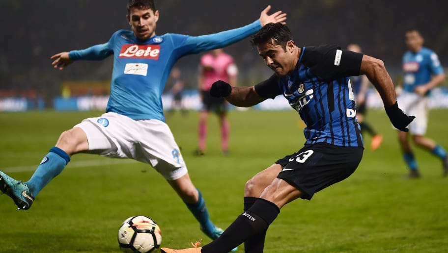 Inter forward Eder Citadin Martins (R) kicks the ball despite Napoli's Brazilian midfielder Jorginho during the Italian Serie A football match Inter Milan vs Napoli on March 11, 2018 at the San Siro stadium in Milan. / AFP PHOTO / MARCO BERTORELLO        (Photo credit should read MARCO BERTORELLO/AFP/Getty Images)