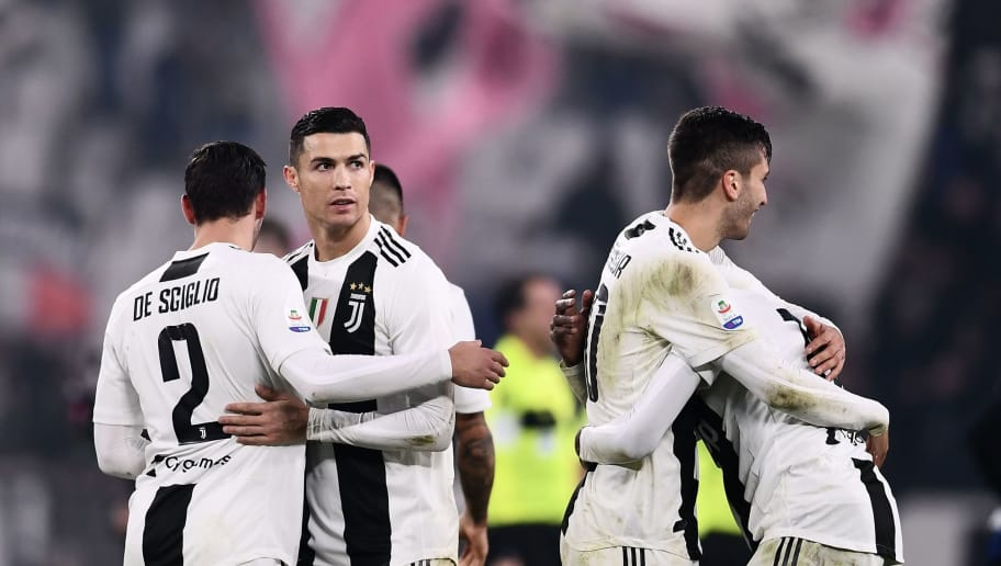 Juventus' Portuguese forward Cristiano Ronaldo (C) celebrates with teammates at the end of the Serie A soccer match Juventus vs InterMilan at the Stadio delle Alpi in Turin on December 7, 2018. (Photo by Marco BERTORELLO / AFP)        (Photo credit should read MARCO BERTORELLO/AFP/Getty Images)
