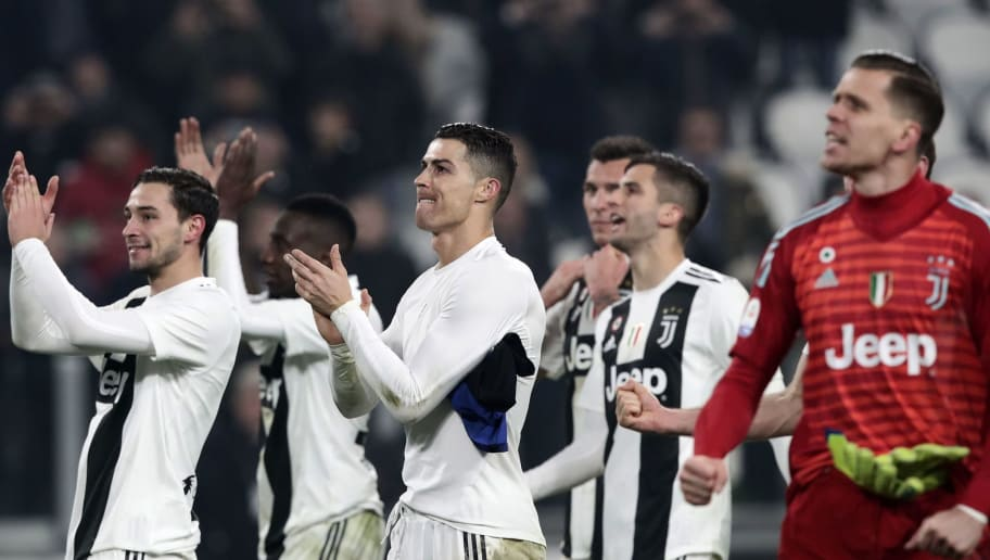 Juventus' Portuguese forward Cristiano Ronaldo (C) celebrates with teammates at the end of the Serie A soccer match Juventus vs InterMilan at the Stadio delle Alpi in Turin on December 7, 2018. (Photo by Isabella BONOTTO / AFP)        (Photo credit should read ISABELLA BONOTTO/AFP/Getty Images)