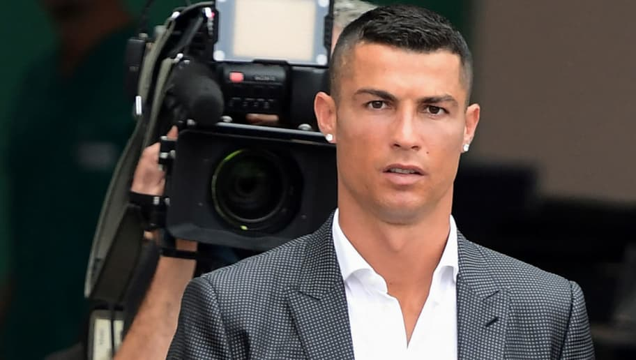 Portuguese footballer Cristiano Ronaldo arrives on July 16, 2018 at the Juventus medical centre at the Alliance stadium in Turin. - A Turin hit by Cristiano Ronaldo fever awaits the striker as Juventus prepare to unveil the surprise signing, that after the end of the World Cup, puts all eyes on the Italian champions and Serie A. (Photo by MIGUEL MEDINA / AFP)        (Photo credit should read MIGUEL MEDINA/AFP/Getty Images)