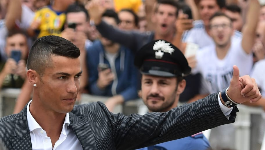 Portuguese footballer Cristiano Ronaldo arrives on July 16, 2018 at the Juventus medical centre at the Alliance stadium in Turin. Cristiano Ronaldo arrived in Turin ahead of his official unveiling as Juventus' superstar summer signing on July 17. - A Turin hit by Cristiano Ronaldo fever awaits the striker as Juventus prepare to unveil the surprise signing, that after the end of the World Cup, puts all eyes on the Italian champions and Serie A. (Photo by MIGUEL MEDINA / AFP)        (Photo credit should read MIGUEL MEDINA/AFP/Getty Images)