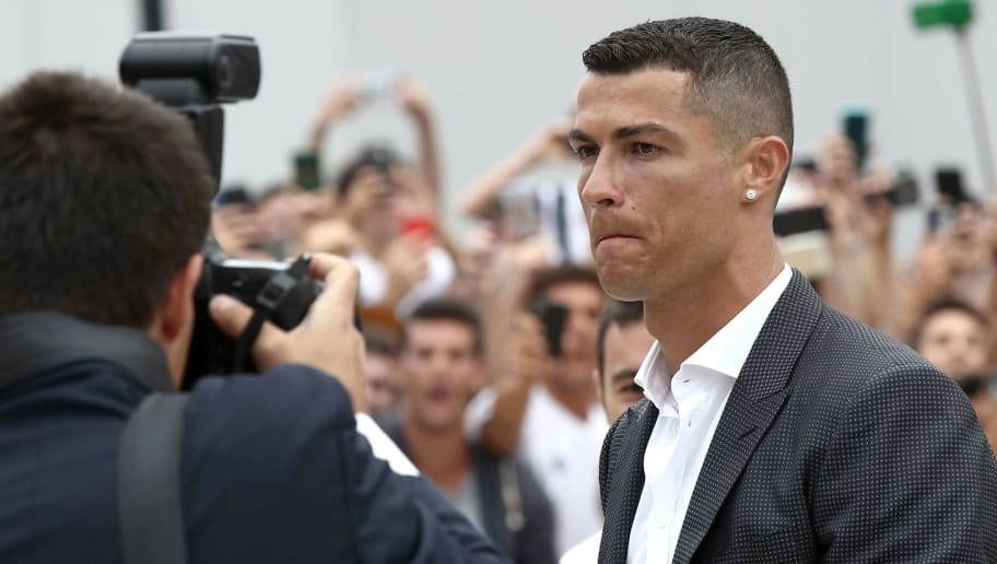 Portuguese footballer Cristiano Ronaldo walks out the Juventus medical center at the Alliance stadium in Turin on July 16, 2018 to greet supporters. - Cristiano Ronaldo arrived in Turin ahead of his official unveiling as Juventus' superstar summer signing on July 17. (Photo by Isabella Bonotto / AFP)        (Photo credit should read ISABELLA BONOTTO/AFP/Getty Images)
