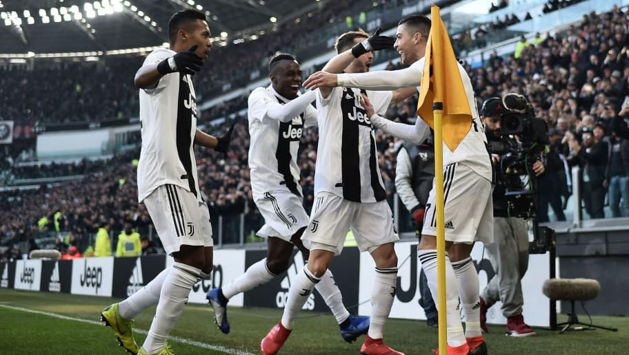 Juventus' Portuguese forward Cristiano Ronaldo (R) celebrates with teammates after opening the scoring during the Italian Serie A football match Juventus vs Sampdoria on December 29, 2018 at the Juventus stadium in Turin. (Photo by Marco BERTORELLO / AFP) / ALTERNATIVE CROP        (Photo credit should read MARCO BERTORELLO/AFP/Getty Images)