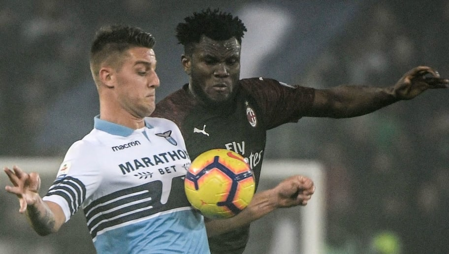 Lazio's Serbian midfielder Sergej Milinkovic-Savic (L) and AC Milan's Ivorian midfielder Franck Kessie go for the ball during the Italian Serie A football match Lazio Rome vs AC Milan on November 25, 2018 at the Olympic stadium in Rome. (Photo by Filippo MONTEFORTE / AFP)        (Photo credit should read FILIPPO MONTEFORTE/AFP/Getty Images)