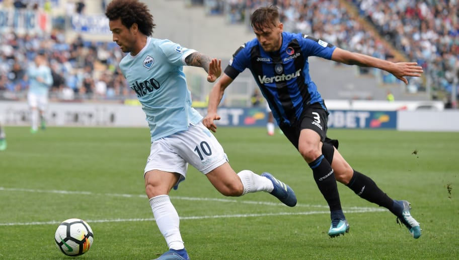 Lazio's midfielder from Brazilian Felipe Anderson fights for the ball with Atalanta's Brazilian defender Rafael Toloi during the Serie A football match between Lazio and Atalanta at Olympic Stadium in Rome on May 6, 2018. (Photo by TIZIANA FABI / AFP)        (Photo credit should read TIZIANA FABI/AFP/Getty Images)