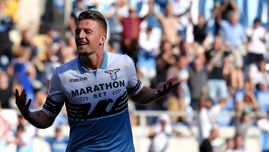 Lazio's Serbian midfielder Sergej Milinkovic-Savic   celebrates after scoring a goal  during the Italian Serie A football match between SS Lazio and Genoa CFC at the Olympic Stadium in Rome on September 23, 2018. (Photo by Tiziana FABI / AFP)        (Photo credit should read TIZIANA FABI/AFP/Getty Images)