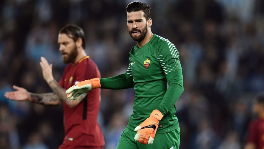 Roma's goalkeeper from Brazil Alisson Ramses Becker reacts during the Italian Serie A football match between Lazio and Roma on April 15, 2018 at Olympic Stadium in Rome. / AFP PHOTO / FILIPPO MONTEFORTE        (Photo credit should read FILIPPO MONTEFORTE/AFP/Getty Images)