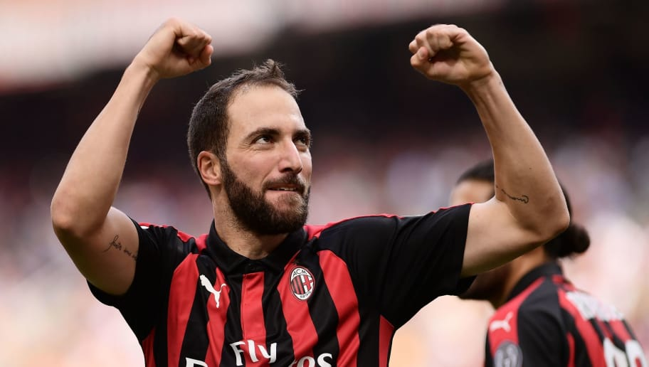 AC Milan's Argentinian forward Gonzalo Higuain celebrates after scoring during the Italian Serie A football match AC Milan vs Chievo Verona at the Giuseppe Meazza stadium in Milan on October 7, 2018. (Photo by MARCO BERTORELLO / AFP)        (Photo credit should read MARCO BERTORELLO/AFP/Getty Images)