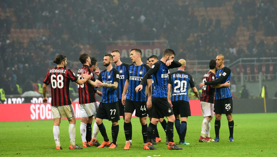 AC Milan and Inter Milan's players shake hands at the end of the Italian Serie A football match AC Milan vs Inter Milan at the San Siro stadium in Milan on April 4, 2018. / AFP PHOTO / MIGUEL MEDINA        (Photo credit should read MIGUEL MEDINA/AFP/Getty Images)
