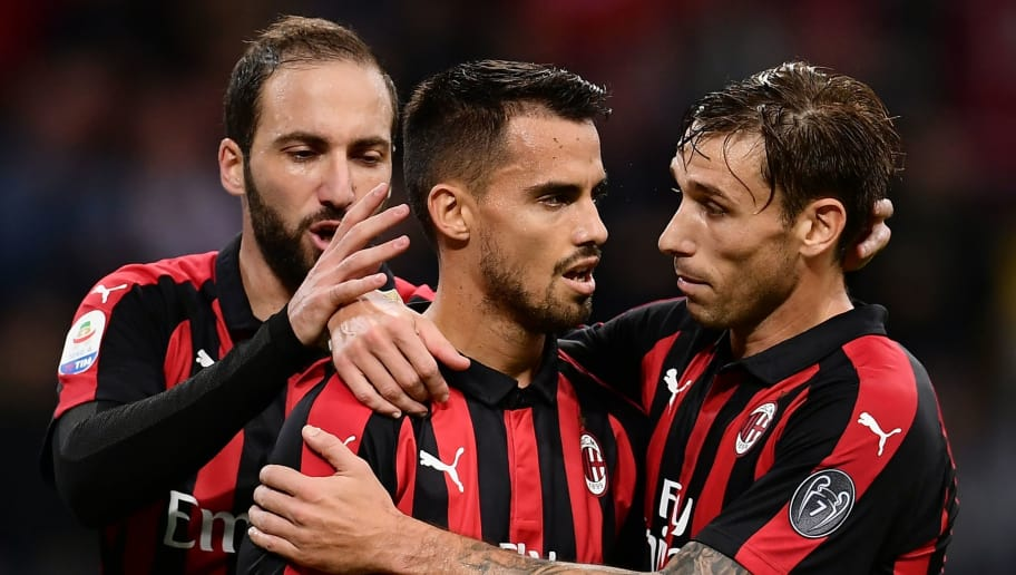 AC Milan's midfielder Suso from Spain (C) celebrates after scoring with his teammate AC Milan's midfielder Lucas Biglia from Argentina (R) and AC Milan's Argentinian forward Gonzalo Higuain (L) during the Italian Serie A football match AC Milan vs Sampdoria on October 28, 2018 at the 'Giuseppe Meazza Stadium' in Milan. (Photo by MARCO BERTORELLO / AFP)        (Photo credit should read MARCO BERTORELLO/AFP/Getty Images)