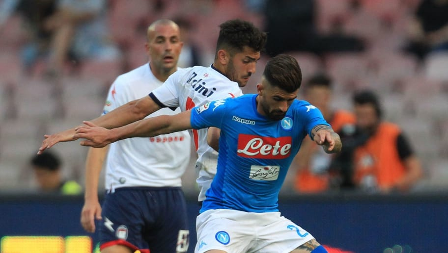 Napoli's Albanian defender Elseid Hysaj (R) fights for the ball with Crotone's Italian forward Andrea Nalini during the Italian Serie A football match SSC Napoli vs FC Crotone on May 20, 2018 at the San Paolo Stadium. (Photo by CARLO HERMANN / AFP)        (Photo credit should read CARLO HERMANN/AFP/Getty Images)