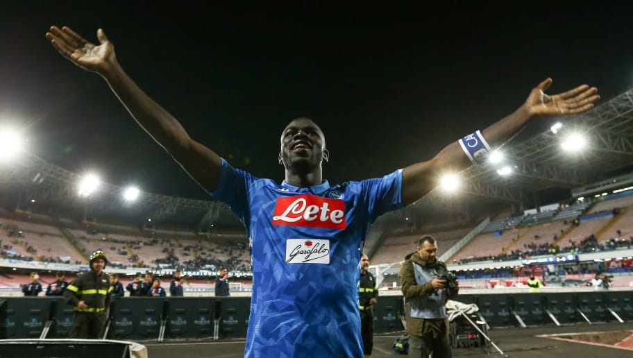 Napoli's French defender Kalidou Koulibaly celebrate at the end of the Italian Serie A football match between SSC Napoli and Parma Calcio 1913 on September 26, 2018, at the San Paolo Stadium in Naples. (Photo by CARLO HERMANN / AFP)        (Photo credit should read CARLO HERMANN/AFP/Getty Images)