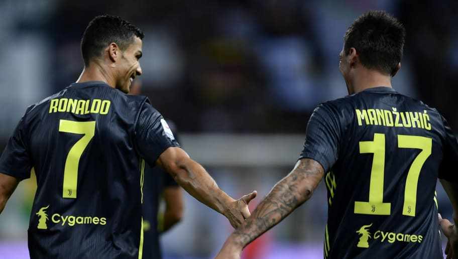 Juventus' Croatian forward Mario Mandzukic (R) is congratulated by Juventus' Portuguese forward Cristiano Ronaldo (L) after scoring a goal during the Italian Serie A football match Parma vs Juventus on September 1, 2018 at Ennio Tardini stadium in Parma. (Photo by Marco BERTORELLO / AFP)        (Photo credit should read MARCO BERTORELLO/AFP/Getty Images)