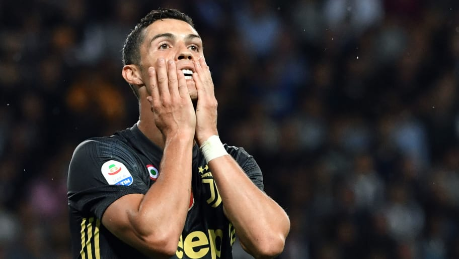 Juventus' Portuguese forward Cristiano Ronaldo reacts after missing a goal opportunity during the Italian Serie A football match Parma vs Juventus on September 1, 2018 at Ennio Tardini stadium in Parma. (Photo by Andreas SOLARO / AFP)        (Photo credit should read ANDREAS SOLARO/AFP/Getty Images)