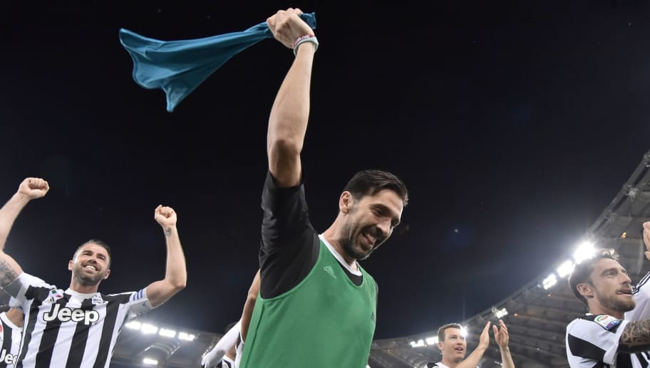 Juventus' goalkeeper from Italy Gianluigi Buffon celebrates with teammates at the end of the Italian Serie A football match AS Roma vs Juventus at the Olympic stadium on May 13, 2018 in Rome. Juventus won a seventh straight Serie A title on Sunday after a goalless draw against ten-man Roma at the Stadio Olimpico. - The Turin giants become the first team to complete the league and Cup double for four consecutive seasons. It is the 34th Scudetto in Juventus's history. (Photo by TIZIANA FABI / AFP)        (Photo credit should read TIZIANA FABI/AFP/Getty Images)