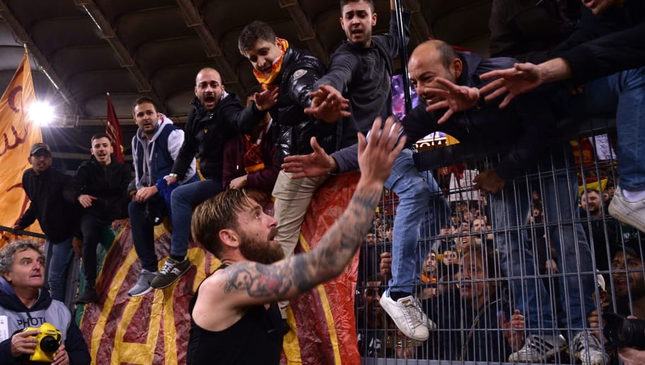 Roma's Italian midfielder Daniele De Rossi celebrates with tifosi after winning the Italian Serie A football match AS Roma vs Lazio on November 18, 2017 at the Olympic stadium in Rome.  / AFP PHOTO / Filippo MONTEFORTE        (Photo credit should read FILIPPO MONTEFORTE/AFP/Getty Images)