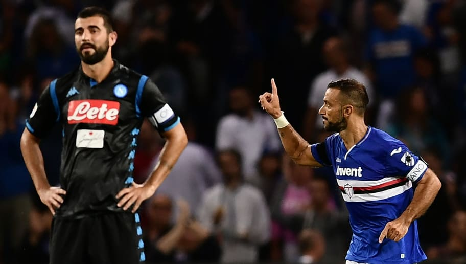 Sampdoria's Italian forward Fabio Quagliarella (R) celebrates after scoring during the Italian Serie A football match Sampdoria vs Napoli on September 2, 2018 at the 'Luigi Ferraris Stadium' in Genoa. (Photo by MARCO BERTORELLO / AFP)        (Photo credit should read MARCO BERTORELLO/AFP/Getty Images)