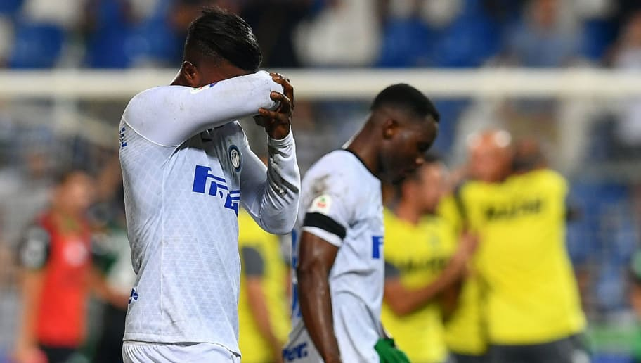 Inter Milan's Senegalese forward Keita Balde (L) reacts as he leaves the pitch at the end of the Italian Serie A football match Sassuolo vs Inter Milan at the Mapei Stadium in Reggio Emilia on August 19, 2018. (Photo by Vincenzo PINTO / AFP)        (Photo credit should read VINCENZO PINTO/AFP/Getty Images)