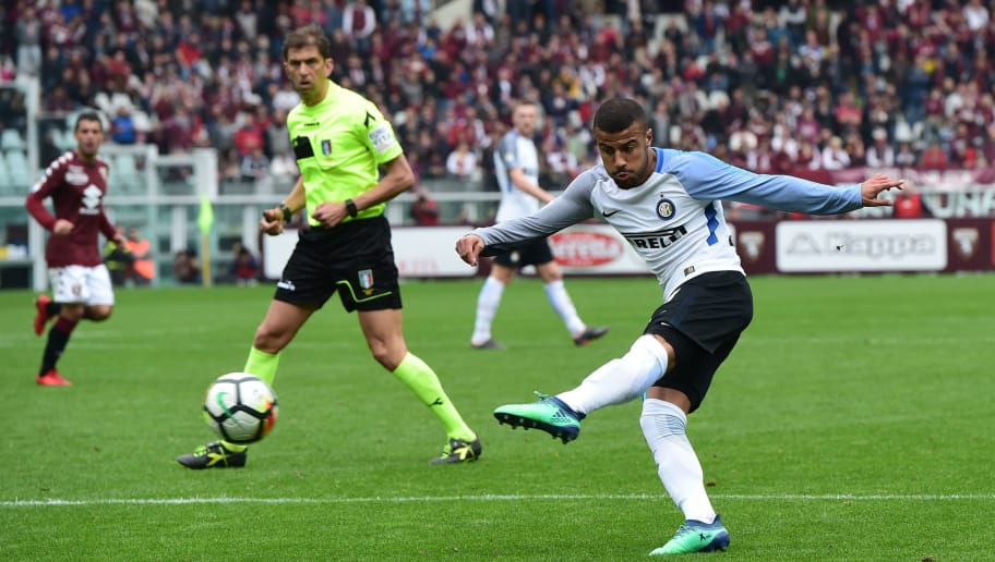 Inter Milan's Brazilian midfielder Rafinha kicks the ball during the Italian Serie A football match Torino FC vs Inter Milan at the Olympic stadium in Turin on April 8, 2018. / AFP PHOTO / MIGUEL MEDINA        (Photo credit should read MIGUEL MEDINA/AFP/Getty Images)
