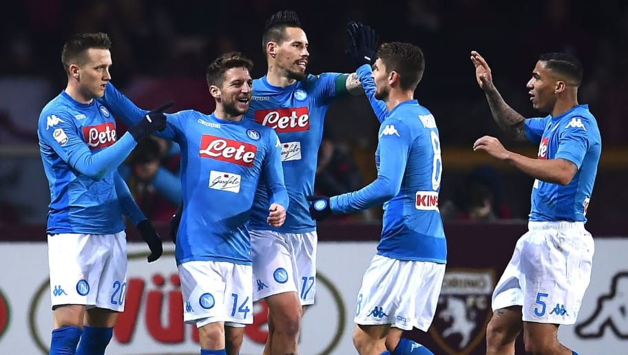 Napoli's midfielder Piotr Zielinski of Poland (L) celebrates with teammates after scoring during the Italian Serie A football match Torino Vs Napoli on December 16, 2017 at the 'Grande Torino' stadium in Turin. / AFP PHOTO / MARCO BERTORELLO        (Photo credit should read MARCO BERTORELLO/AFP/Getty Images)